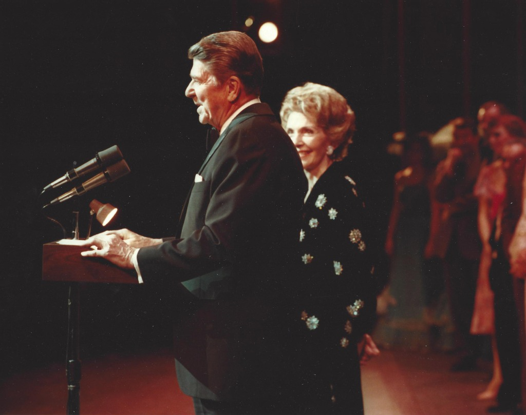 Ronald Reagan gives a speech at The National Theatre as wife Nancy watches on.